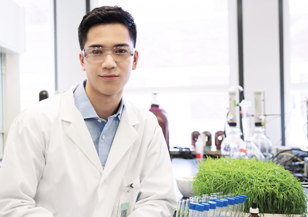 Confident young scientist in laboratory