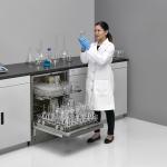 Undercounter FlaskScrubber Glassware Washer, with Scientist Holding Glassware