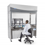 Logic Vue Class II Enclosure with scientist working while seated