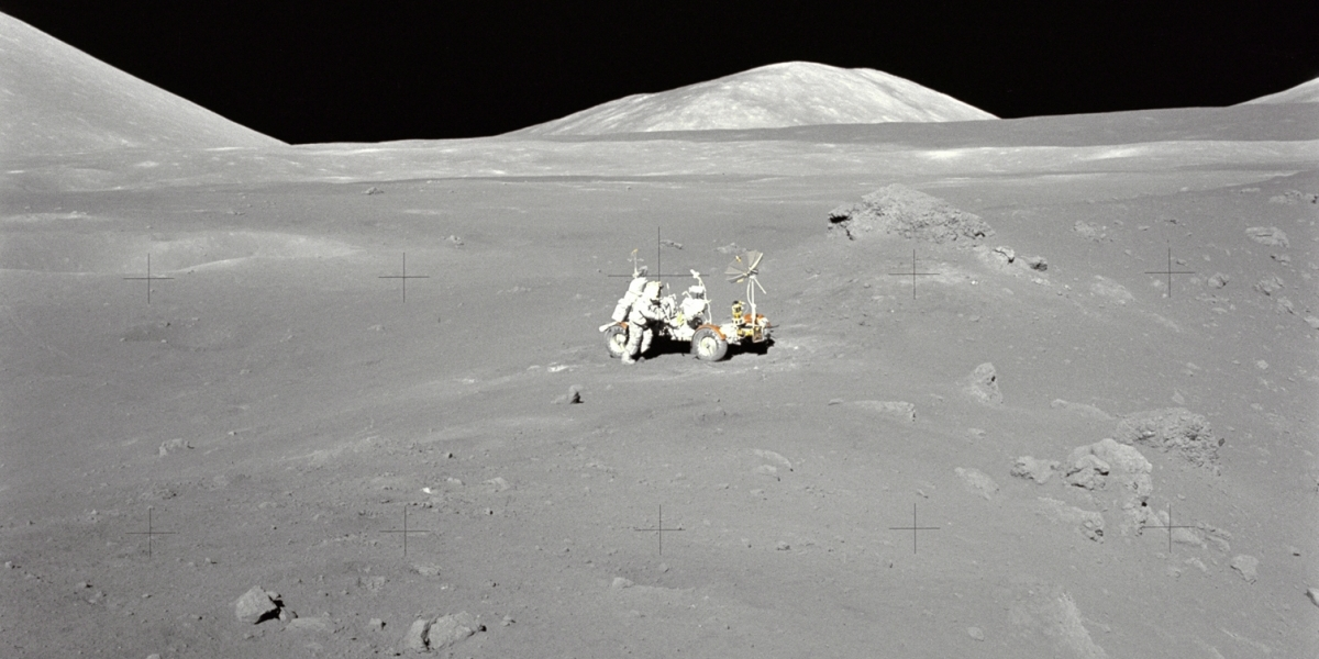 Moon rover in regolith on lunar surface